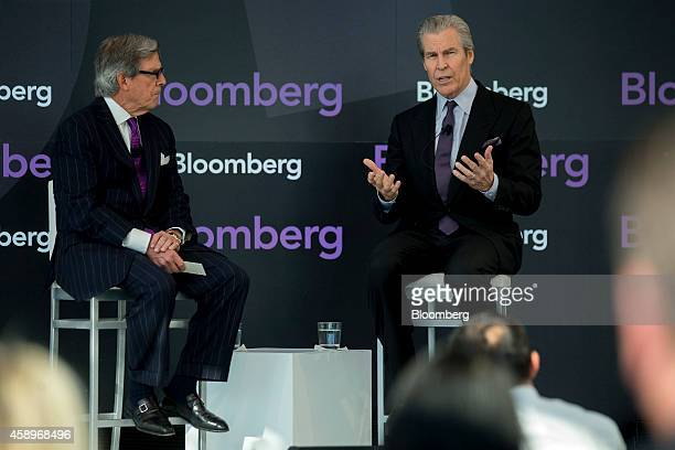 Terry Lundgren, president and chief executive officer of Macy's Inc., right, speaks during a discussion with Peter Grauer, chairman of Bloomberg LP,...