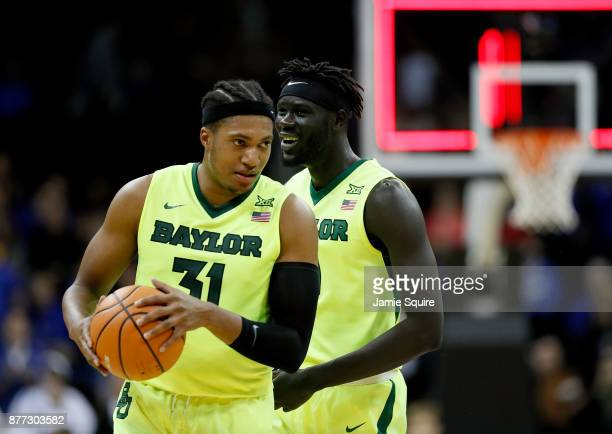 Terry Maston and Jo LualAcuil Jr #0 of the Baylor Bears celebrate as the Bears defeated the Creighton Bluejays to win the National Collegiate...