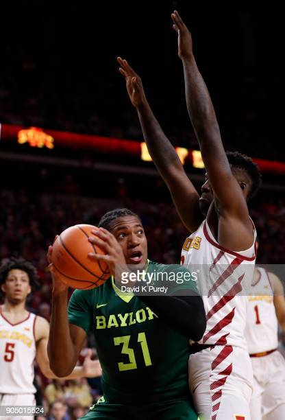 Terry Maston of the Baylor Bears takes a shot as Cameron Lard of the Iowa State Cyclones blocks in the second half of play at Hilton Coliseum on...