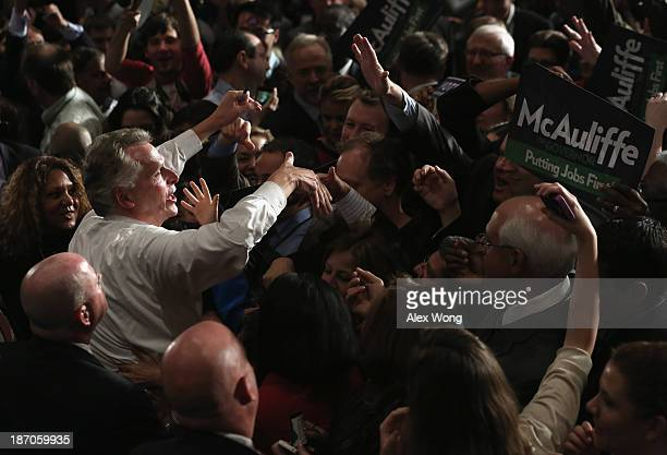 Terry McAuliffe greets supporters during an electionnight party after winning the Virginia governor's race November 5 2013 at Sheraton Premiere Hotel...
