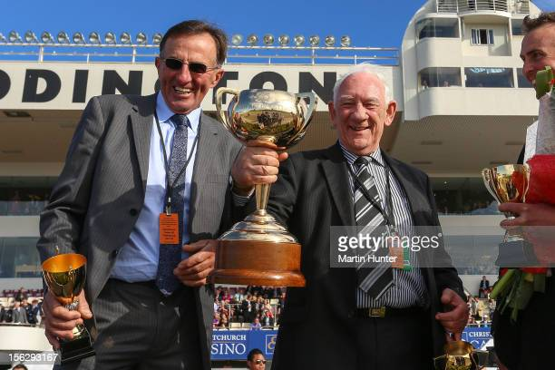 Terry McDonald owner of Terror To Love poses with trainer Graham Court after winning the NZ Trotting Cup at Addington Raceway on November 13 2012 in...