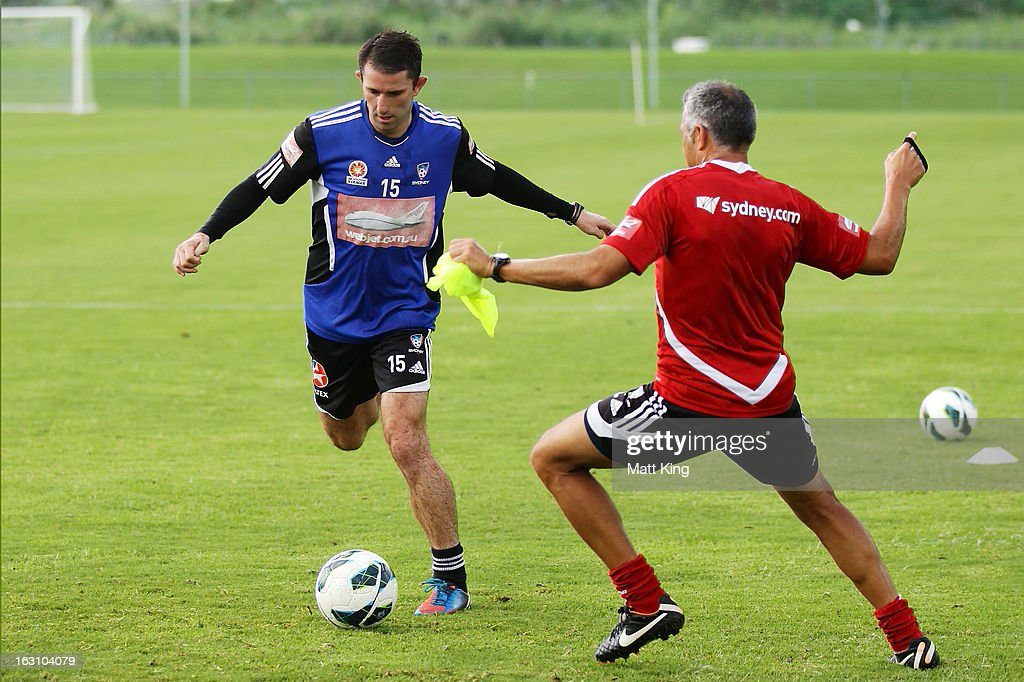 Terry McFlynn completes a drill with assistant coach Steve Corica during a Sydney FC A-League training session at Macquarie Uni on March 5, 2013 in Sydney, Australia.