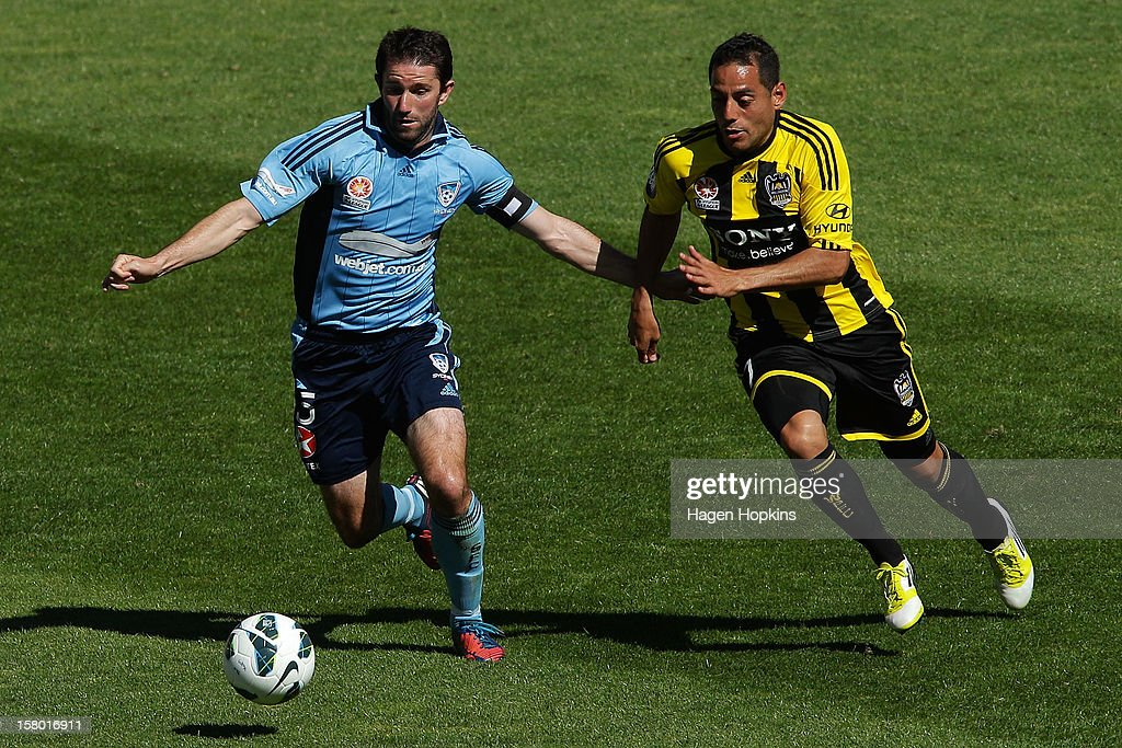 Terry McFlynn of Sydney FC and Leo Bertos of the Phoenix compete for the ball during the round 10 A-League match between Wellington Phoenix and Sydney FC at Westpac Stadium on December 9, 2012 in Wellington, New Zealand.