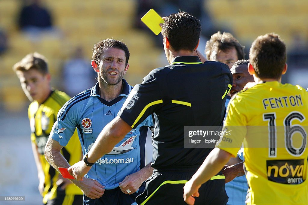 Terry McFlynn of Sydney FC talks to referee Kris Griffiths-Jones before receiving a red card during the round 10 A-League match between Wellington Phoenix and Sydney FC at Westpac Stadium on December 9, 2012 in Wellington, New Zealand.