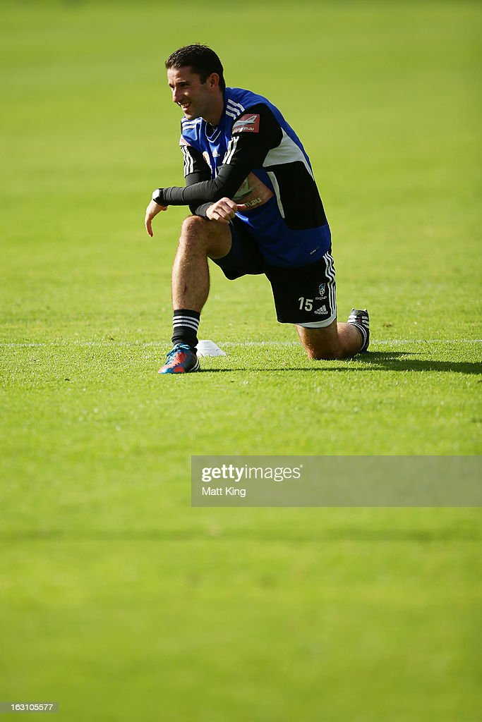 Terry McFlynn stretches during a Sydney FC A-League training session at Macquarie Uni on March 5, 2013 in Sydney, Australia.