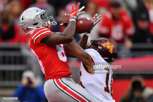 Terry McLaurin of the Ohio State Buckeyes catches a 41yard touchdown pass in the first quarter as Coney Durr of the Minnesota Golden Gophers defends...