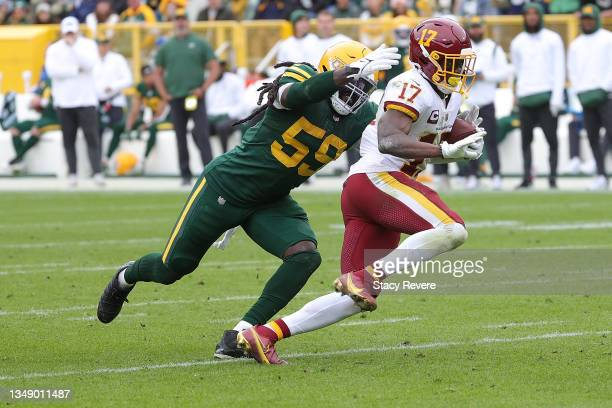 Terry McLaurin of the Washington Football Team is pursued by De'Vondre Campbell of the Green Bay Packers during a game at Lambeau Field on October...