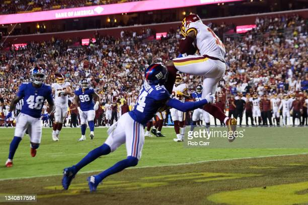 Terry McLaurin of the Washington Football Team makes a reception for a touchdown over James Bradberry of the New York Giants during the second...