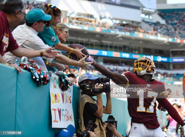 Terry McLaurin of the Washington Redskins gives the football to a fan after scoring a touchdown in the first half of the game against the Miami...