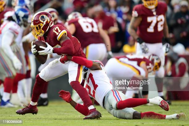 Terry McLaurin of the Washington Redskins is tackled by Deandre Baker of the New York Giants in the first half at FedExField on December 22 2019 in...