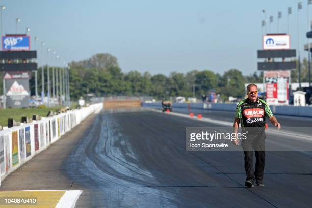 Terry McMillen NHRA Top Fuel Dragster walks down the track before the start of the NHRA AAA Midwest Nationals on September 23 at Gateway Motorsports...