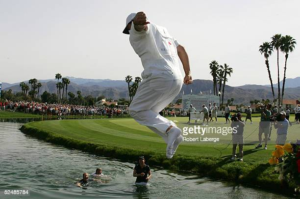 Terry McNamara caddie for Annika Sorenstam of Sweden jumps into Champions Lake as Annika her sister Charlotta and mother Gunilla celebrate in the...