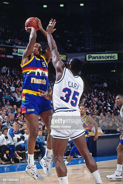 Terry Mills of the Denver Nuggets shoots the ball during a game against the Sacramento Kings circa 1991 at Arco Arena in Sacramento California NOTE...