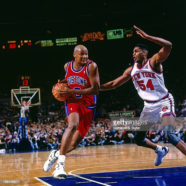 Terry Mills of the Detroit Pistons drives against Charles Smith of the New York Knicks during a game played circa 1995 at the Madison Square Garden...