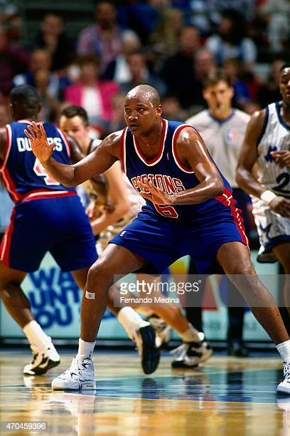 Terry Mills of the Detroit Pistons plays defense against the Orlando Magic on April 5 1995 at the Orlando Arena in Orlando Florida NOTE TO USER User...