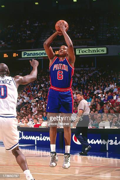 Terry Mills of the Detroit Pistons shoots against Olden Polynice of the Sacramento Kings during a game played on March 14 1994 at Arco Arena in...