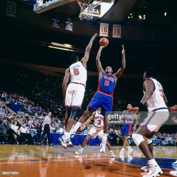 Terry Mills of the Detroit Pistons shoots during a game played on December 16 1995 at Madison Square Garden in New York City NOTE TO USER User...