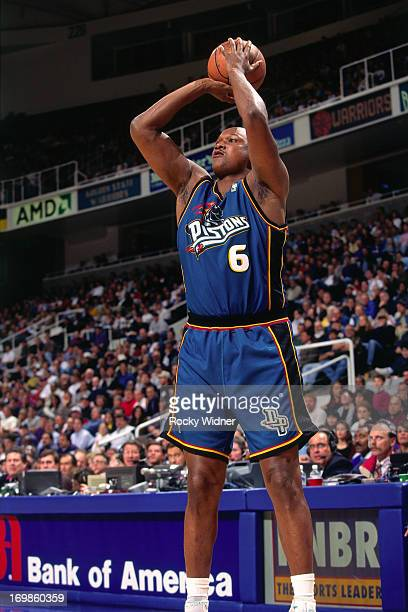 Terry Mills of the Detroit Pistons shoots the ball against the Golden State Warriors during a game played on January 23 1997 at the San Jose Arena in...