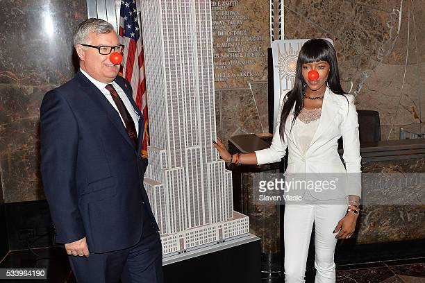 Terry Mills VP Partnerships of Red Nose Day and Naomi Campbell light The Empire State Building in honor of Red Nose Day at The Empire State Building...