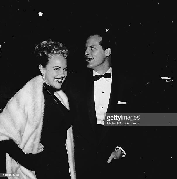 Terry Moore and Eugene McGarth attend the movie premiere of Bundle of Joy in Los AngelesCA