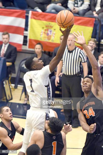Terry Nolan Jr #1 of the George Washington Colonials drives to the basket during a college basketball game against the Princeton Tigers at the Smith...