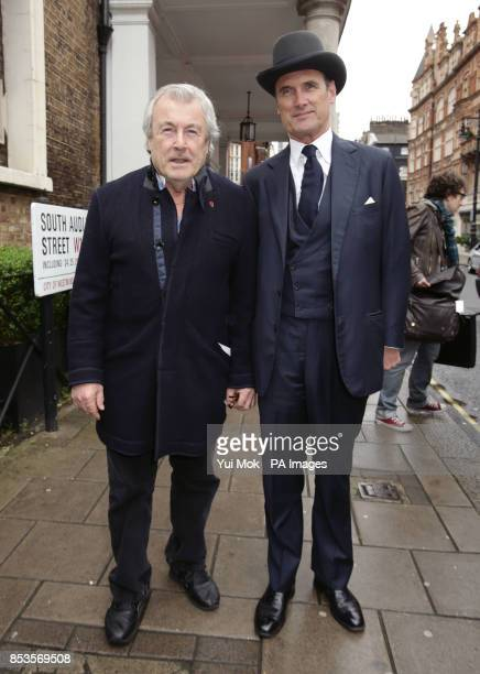 Terry O'Neill and AA Gil after attending a memorial service for Alan Whicker at Grosvenor Chapel in London