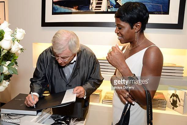 Terry O'Neill and Cheryl Fox attend a gallery exhibit of Terry O'Neill Presents The Opus A 50 Year Retrospective at Mouche Gallery on June 19 2013 in...