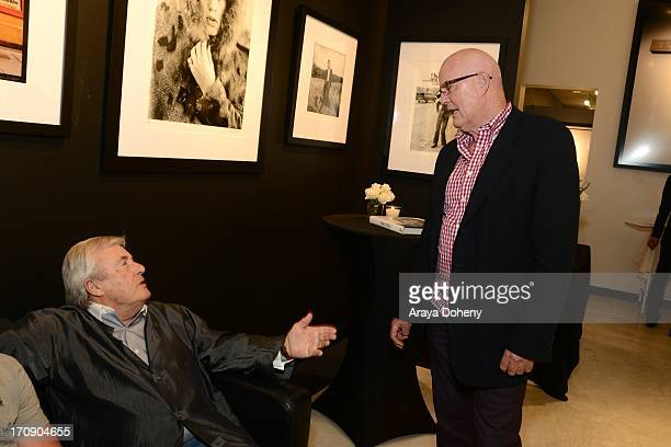 Terry O'Neill and Eddie Sanderson attend a gallery exhibit of Terry O'Neill Presents The Opus A 50 Year Retrospective at Mouche Gallery on June 19...