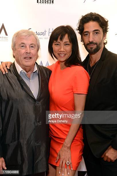 Terry O'Neill Keiko Noah and Arno Elias attend a gallery exhibit of Terry O'Neill Presents The Opus A 50 Year Retrospective at Mouche Gallery on June...