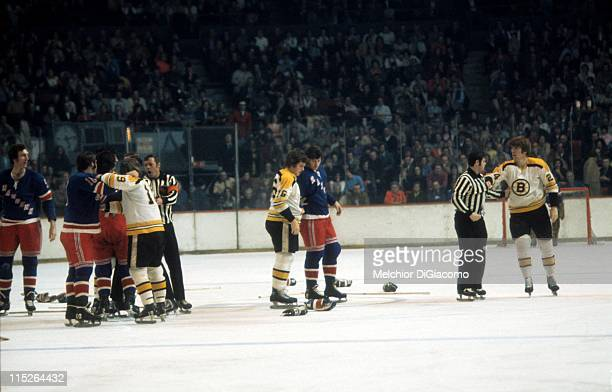 Terry O'Reilly of the Boston Bruins is held to the side after a fight with Brad Park of the New York Rangers as Fred O'Donnell of the Bruins and...