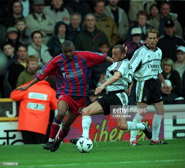Terry Phelan of Fulham and Clintn Morrison of Palace in action during the match between Fulham v Crystal Palace in the Nationwide League Division One...