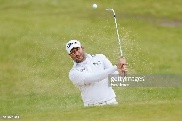 Terry Pilkadaris of Australia plays out of a bunker on day three of the 2014 Scottish Hydro Challenge hosted by MacDonald Hotels Resorts at Spey...