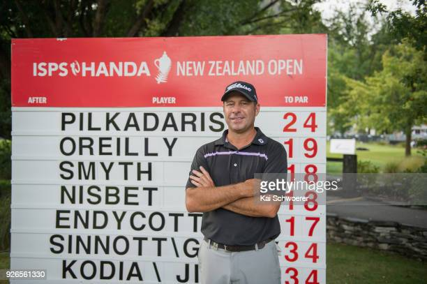 Terry Pilkadaris of Australia poses in front of the leaderboard during day three of the ISPS Handa New Zealand Golf Open at Millbrook Golf Resort on...