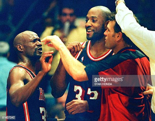 Terry Porter Alonzo Mourning and Dan Majerle of the Miami Heat celebrate the closing seconds of the victory against the New York Knicks in the fourth...