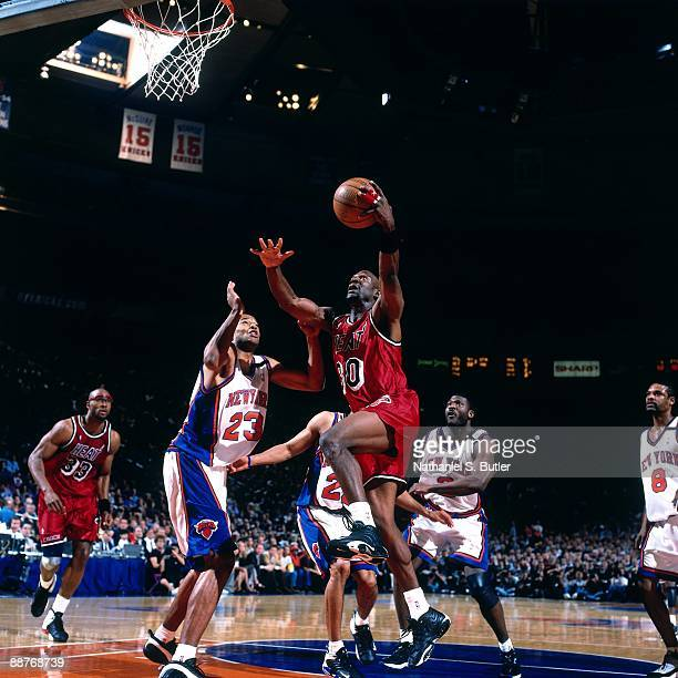 Terry Porter of the Miami Heat drives to the basket against Marcus Camby of the New York Knicks in Game Three of the Eastern Conference Quarterfinals...