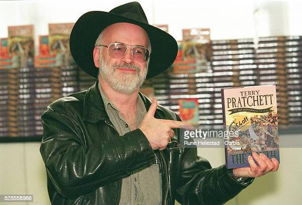 Terry Pratchett launches his 25th novel of the 'Discworld' series 'The Truth' He is a British authof humorous fantasy books science fiction and young...