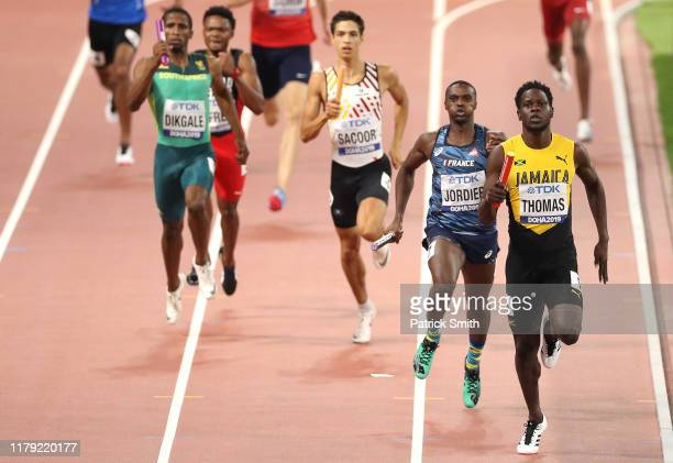 Terry Ricardo Thomas of Jamaica and Thomas Jordier of France compete in the Men's 4x400 metres relay heats during day nine of 17th IAAF World...