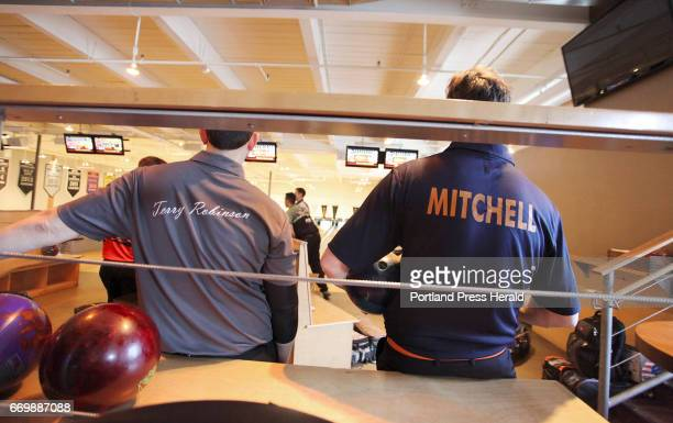 Terry Robinson and Charlie Mitchell watch bowlers in between their turns while amateurs from Maine compete against top professional bowlers in the...