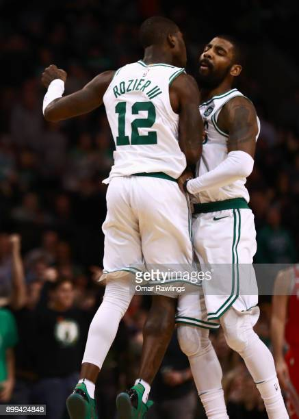 Terry Rozier and Kyrie Irving of the Boston Celtics chest bump during the second half of the game against the Houston Rockets at TD Garden on...