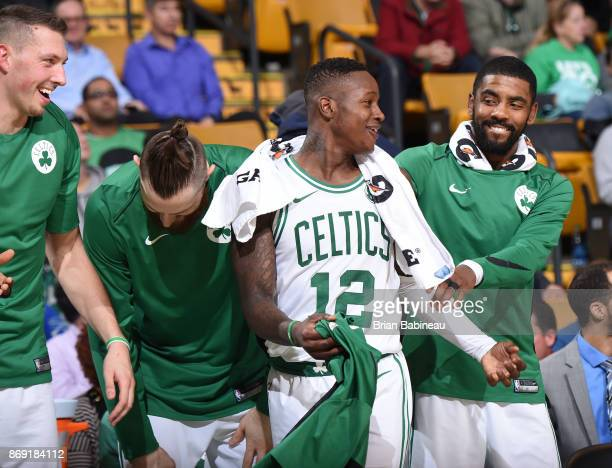 Terry Rozier and Kyrie Irving of the Boston Celtics react to a play against the Sacramento Kings on November 1 2017 at the TD Garden in Boston...
