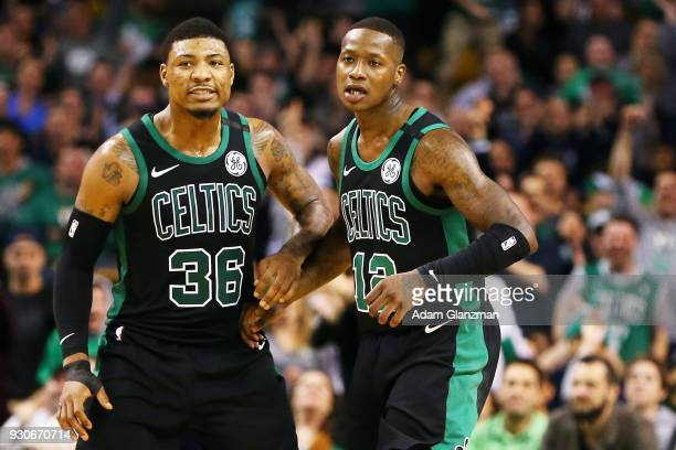 Terry Rozier and Marcus Smart of the Boston Celtics react after a threepoint shot during a game against the Indiana Pacers at TD Garden on March 11...