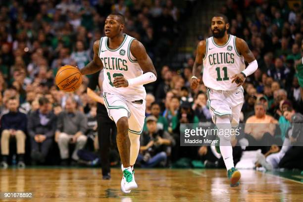 Terry Rozier of the Boston Celtics and Kyrie Irving make their way down court during the second half against the Minnesota Timberwolves at TD Garden...