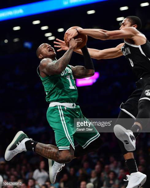 Terry Rozier of the Boston Celtics attempts a basket against Spencer Dinwiddie of the Brooklyn Nets during the second quarter of the game at Barclays...