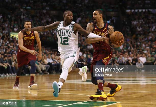 Terry Rozier of the Boston Celtics attempts to steal the ball from George Hill of the Cleveland Cavaliers in the first half during Game Two of the...