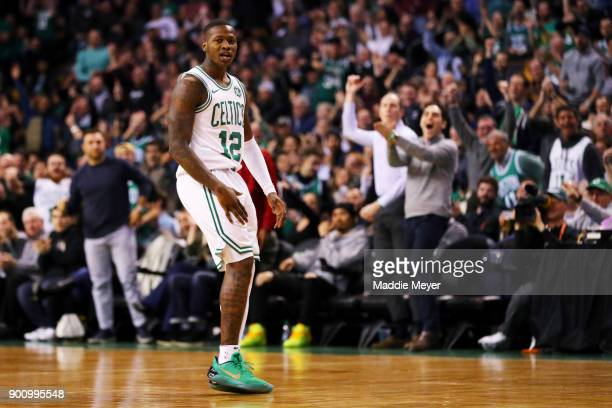 Terry Rozier of the Boston Celtics celebrates after hitting a three point shot against the Cleveland Cavaliers during the first quarter at TD Garden...