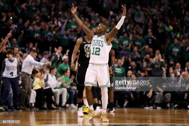 Terry Rozier of the Boston Celtics celebrates in the first quarter of Game Two against the Milwaukee Bucks in Round One of the 2018 NBA Playoffs at...
