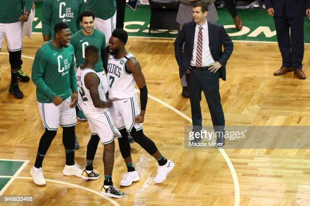 Terry Rozier of the Boston Celtics celebrates with Jaylen Brown during the fourth quarter of Game One of Round One of the 2018 NBA Playoffs against...