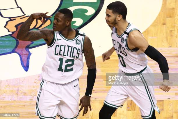 Terry Rozier of the Boston Celtics celebrates with Jayson Tatum after hitting a three point shot during the fourth quarter of Game One of Round One...