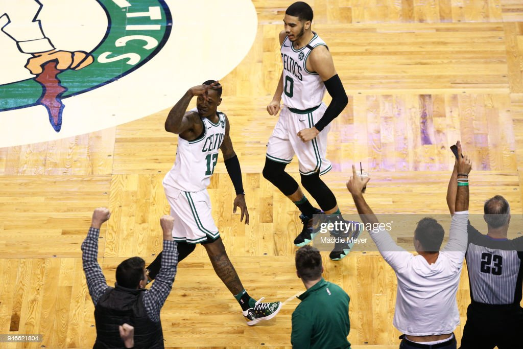 Terry Rozier #12 of the Boston Celtics celebrates with Jayson Tatum #0 after hitting a three point shot during the fourth quarter of Game One of Round One of the 2018 NBA Playoffs against the Milwaukee Bucks during at TD Garden on April 15, 2018 in Boston, Massachusetts.