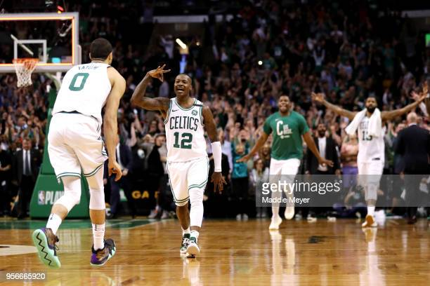 Terry Rozier of the Boston Celtics celebrates with Jayson Tatum after hitting a three point shot to end the first half against the Philadelphia 76ers...